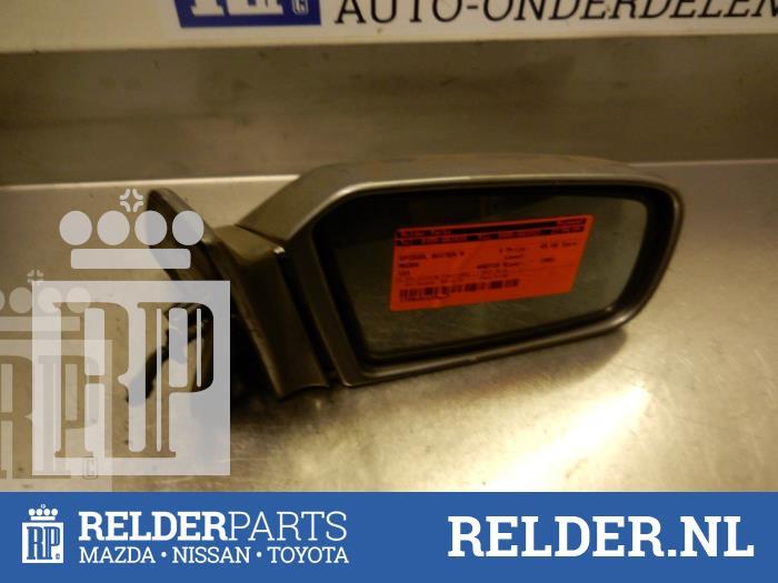 Mazda 121 (DB) 1.3i GL,GLX,Top 16V 1993 Spiegel Buiten rechts (klik op de afbeelding voor de volgende foto)