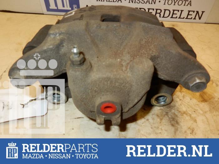 Nissan Juke (F15) 1.6 DIG-T 16V 2013 Remklauw (Tang) links-voor (klik op de afbeelding voor de volgende foto)