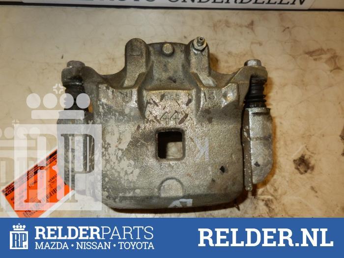 Nissan Juke (F15) 1.5 dCi 2013 Remklauw (Tang) links-voor (klik op de afbeelding voor de volgende foto)