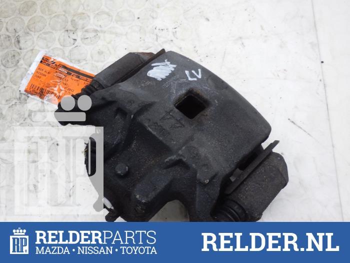Nissan Juke (F15) 1.5 dCi 2012 Remklauw (Tang) links-voor (klik op de afbeelding voor de volgende foto)