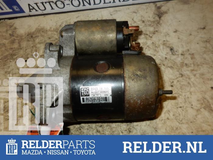 Mazda Demio 1.3 16V 1999 Startmotor (klik op de afbeelding voor de volgende foto)