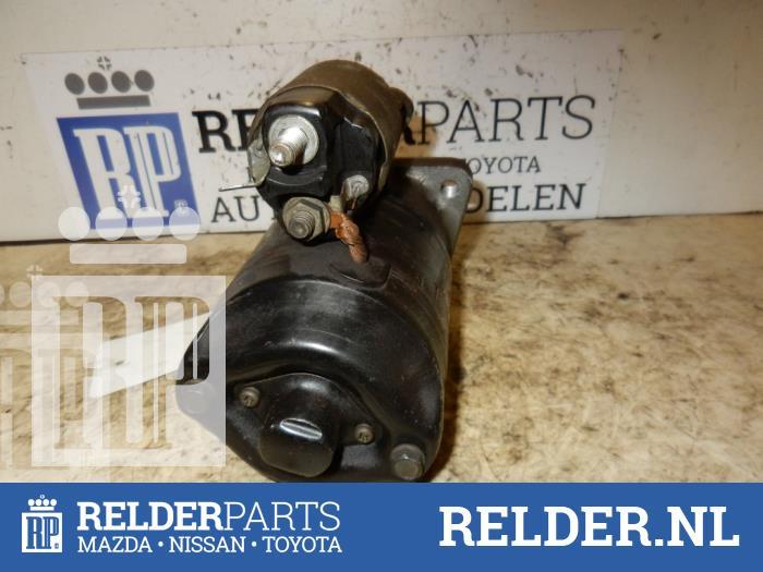 Mazda MX-3 1.6i 16V 1994 Startmotor (klik op de afbeelding voor de volgende foto)