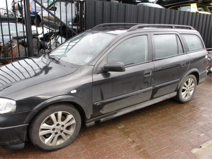 Driehoeks Ruit links-achter van een Opel Astra G Caravan (F35) 2.0 DTi 16V 2002
