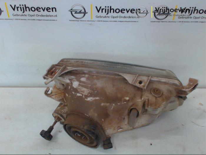 Linker Koplamp van een Opel Astra F (53/54/58/59) 1.4i 16V 1998